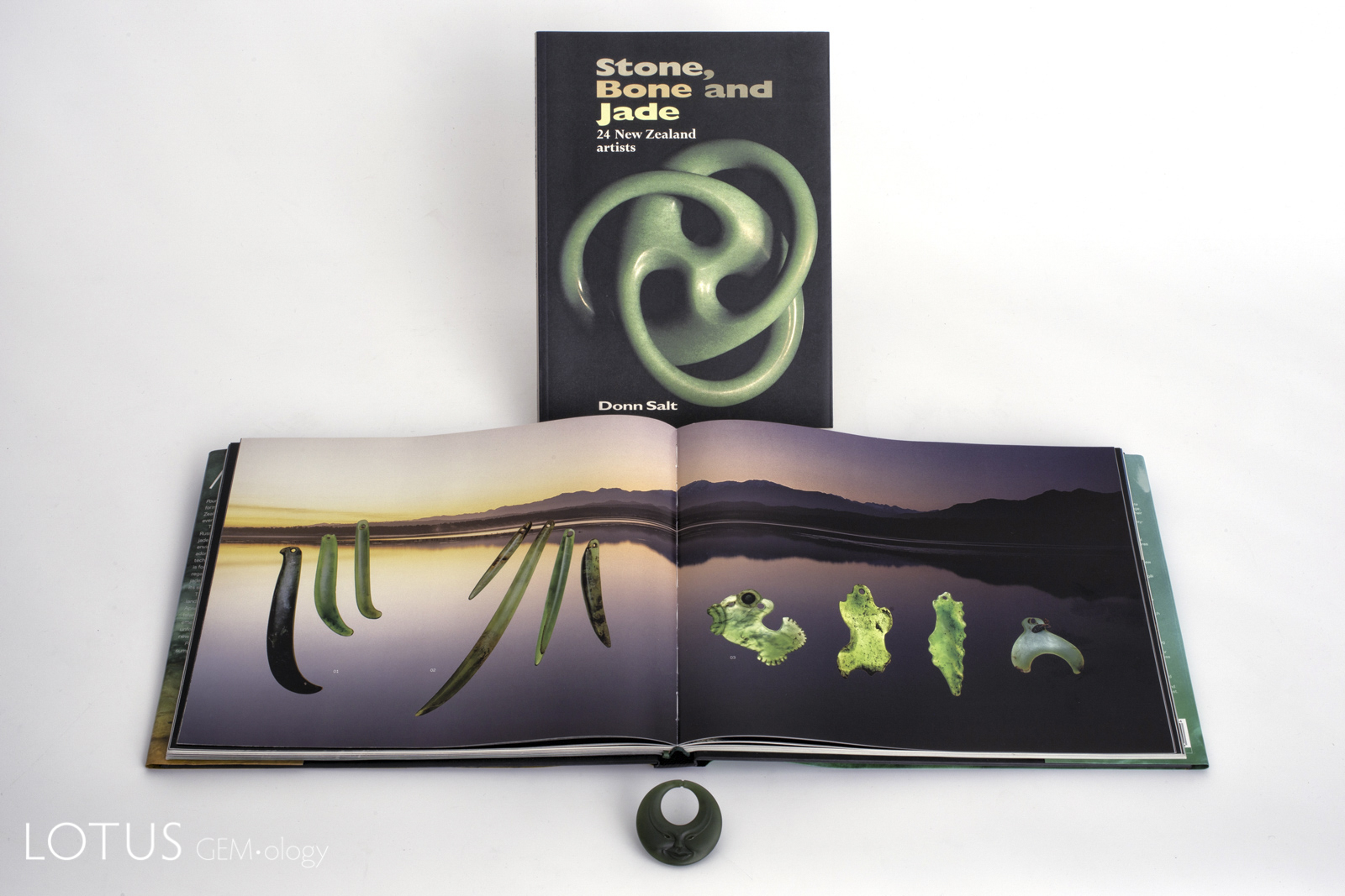 Master carver Donn Salt's book on New Zealand carving sits above a spread from Beck and Mason's lavish 2010 Pounamu: The Jade of New Zealand. In the foreground is an original Donn Salt carving in New Zealand nephrite jade.