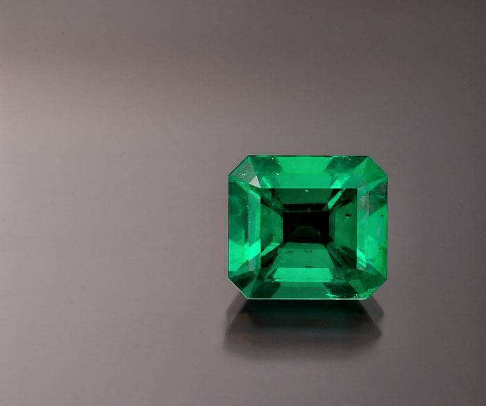 Figure 5. Emerald was once thought to be colored solely by chromium; indeed, many gemologists argued that the definition of emerald must include the presence of chromium. When vanadium-colored emeralds were discovered, the problem with this definition was clearly revealed. In reality, jewelers have no easy way of determining a gem's coloring agent. What they do have are eyes that can see green in a variety of nuances. Gemology cannot live solely in a test-tube environment. It must take into account commercial realities and aesthetic factors. Photo: Wimon Manorotkul; specimen: Palagems.com.
