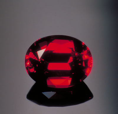 This well-cut Thai/Cambodian ruby shows a combination of both brilliance and extinction. Photo by the author.