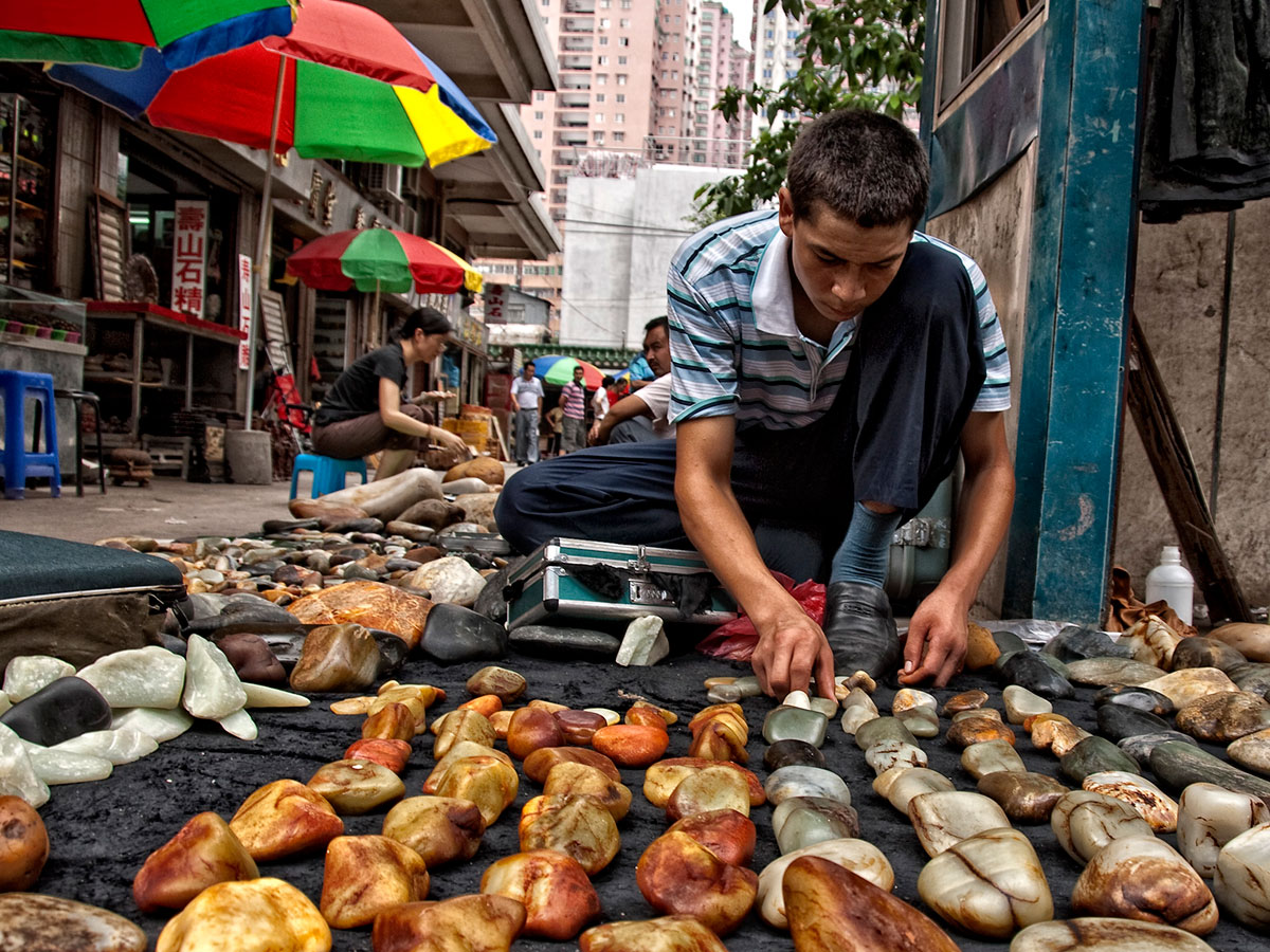 A Uyghur sells jade boulders Guangzhou, China's Hualin Street jade market. From Lotus Gemology.