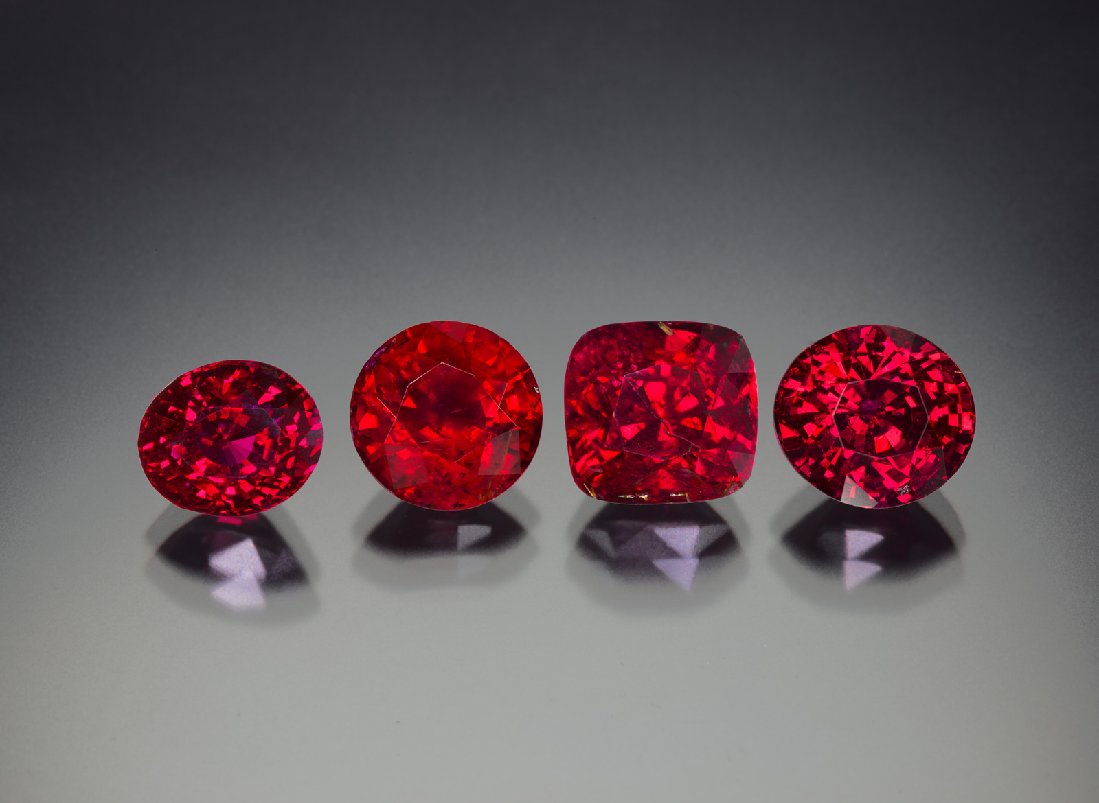 Four untreated rubies from the new find in Madagascar, ranging in size from 4.0 to 6.5 ct. As can be seen, the new production is extremely gemmy. Photo: Wimon Manorotkul/Lotus Gemology.