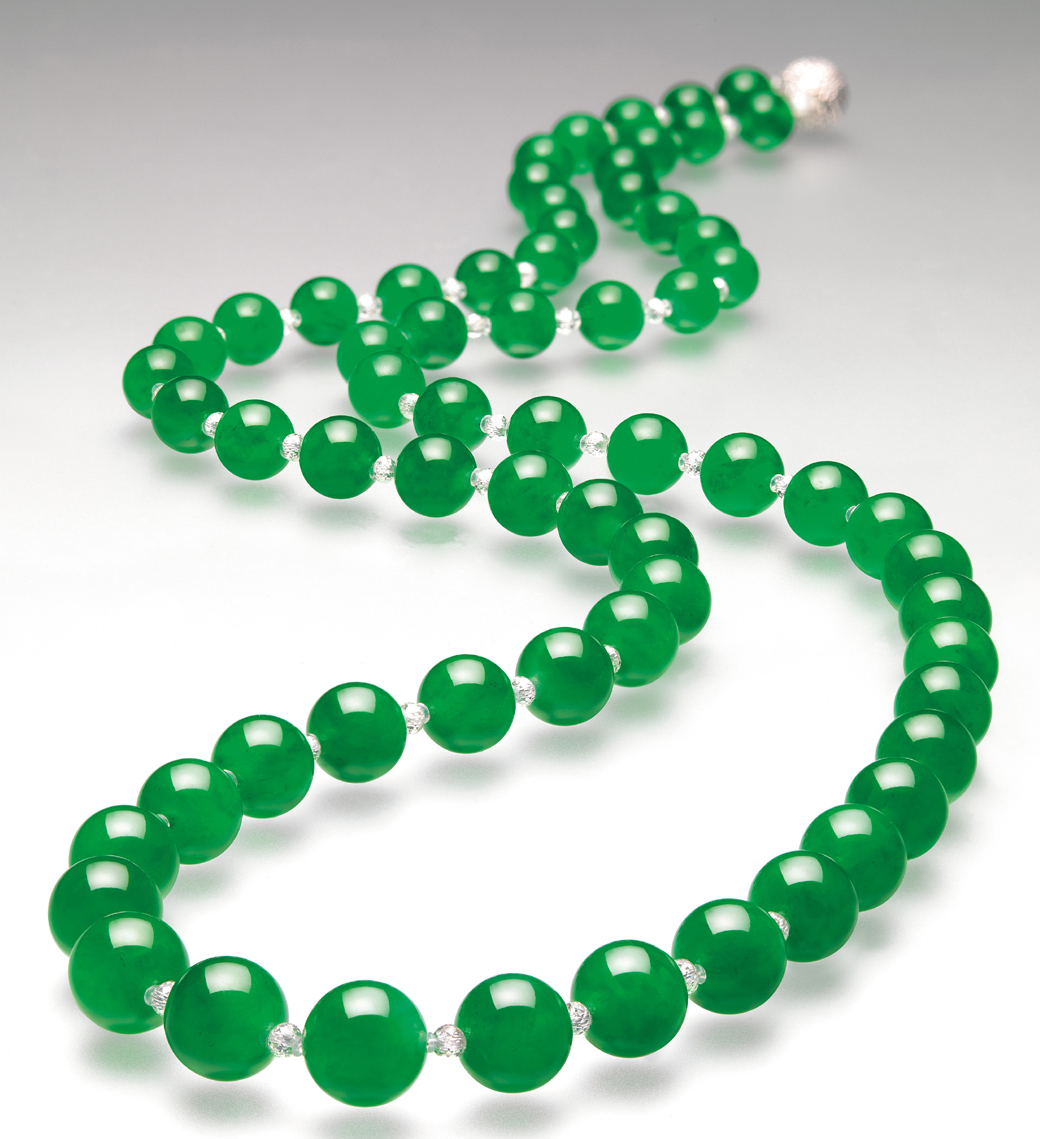 "Figure 4. Doubly Fortunate In 1997, this necklace of 27 perfectly matched beads cut from the famous ""Doubly Fortunate"" jadeite boulder set a new record for jade, selling for an amazing US$9,390,922. Image © Christie's"