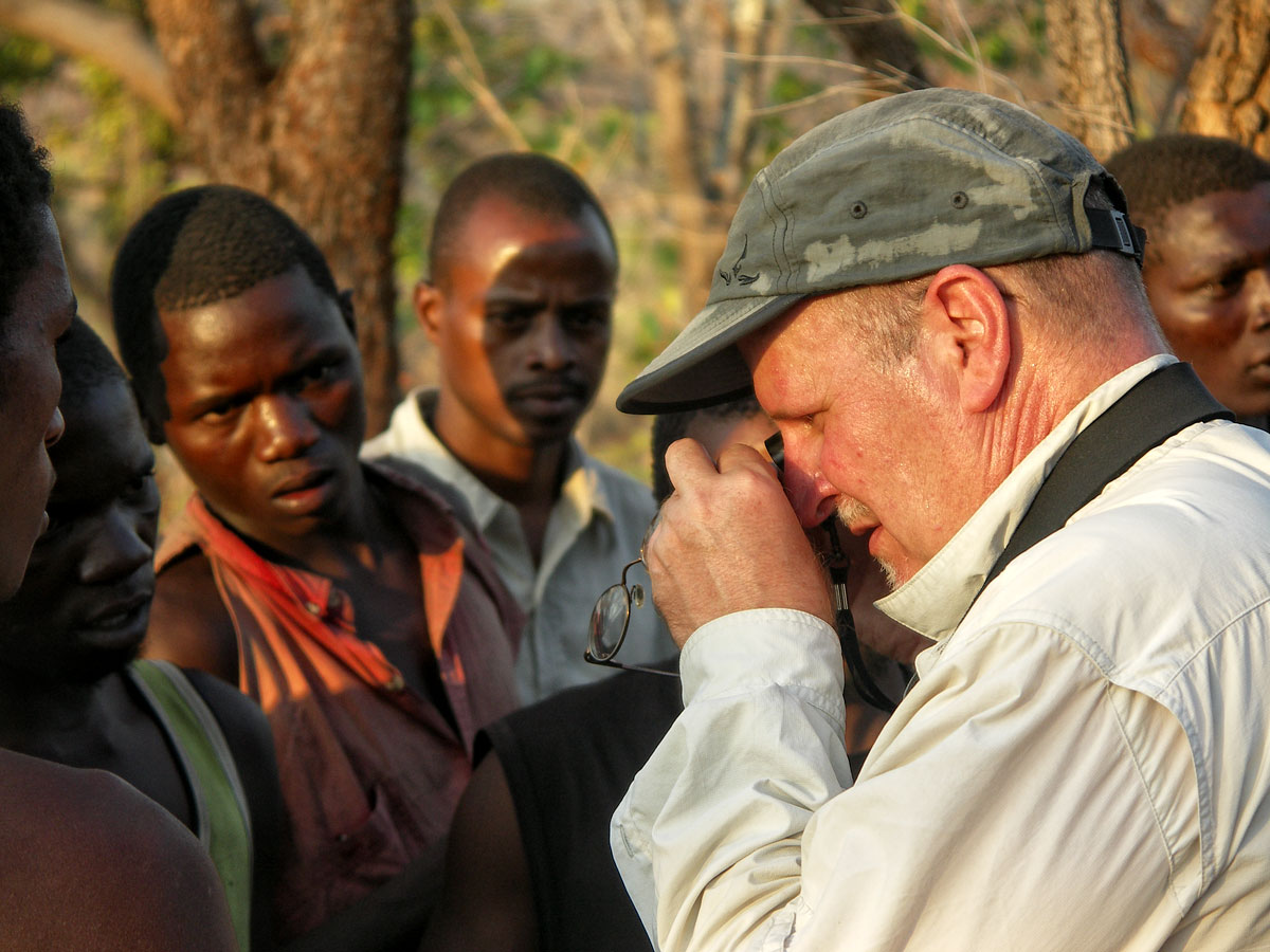 Richard Hughes examining a sapphire in Tanzania's Tunduru district