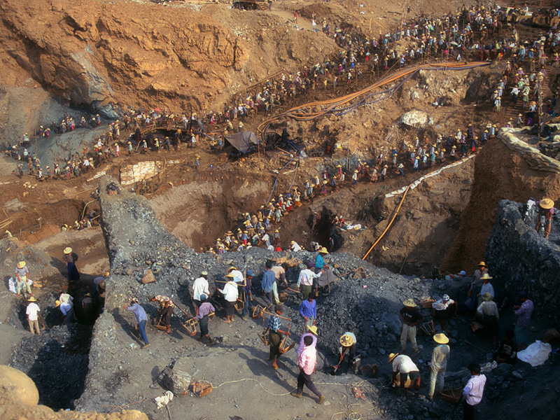 Building the pyramids Over 10,000 miners snake up the hillside at Hpakangyi.