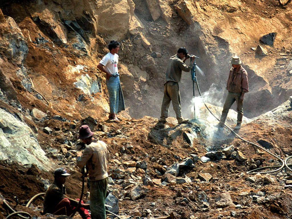 Figure 6. Once a dike is exposed at Tawmaw, jackhammers are needed to break the jadeite apart. Photo © Richard W. Hughes.