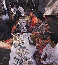 Vendors work the morning jadeite market in Mandalay