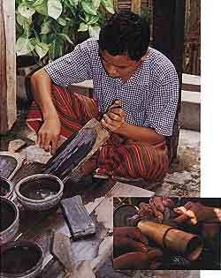 Figure 18. In Mandalay, cutters still use a board coated with a mixture of carborundum (of various grits) and hard wax to shape cabochons (photo by Mark Smith). They then polish jadeite on bamboo lathes, often without any abrasive (inset photo © 2000 Fred Ward).