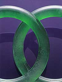 "Figure A-1. Although nephrite jade is China's original ""Stone of Heaven,"" fine jadeite, as in this matched pair of semi-transparent bangles (53.4 mm in interior diameter, 9.8 mm thick), is the most sought-after of jades in the Chinese community today. Photo courtesy of and © Christie's Hong Kong and Tino Hammid."