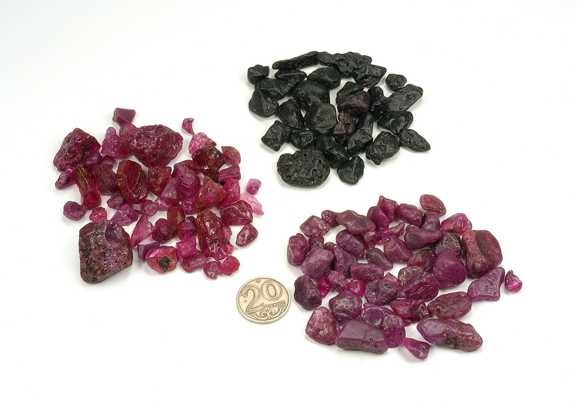 "Three lots of ""ruby"" reputed to be from Tajikistan and obtained from a source in Tashkent, Uzbekistan. While the lower two are indeed ruby, the top lot proved to be dark red garnet. Photo: Wimon Manorotkul/Pala International"