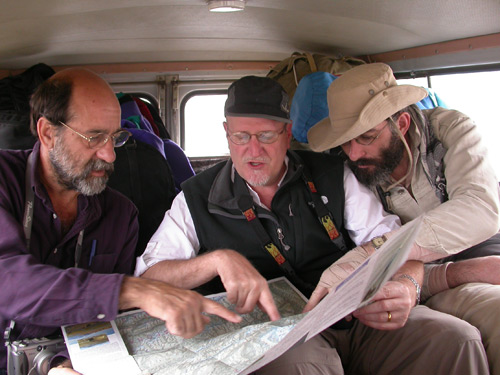 Dana Schorr, Richard Hughes and Vincent Pardieu examine the route to Badakhshan's ruby and spinel mines. Photo: Surat Toimastov