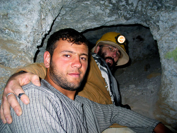 A miner with Vincent Pardieu inside the ancient galleries at Kuh-i-Lal spinel mines. Photo: Dana Schorr