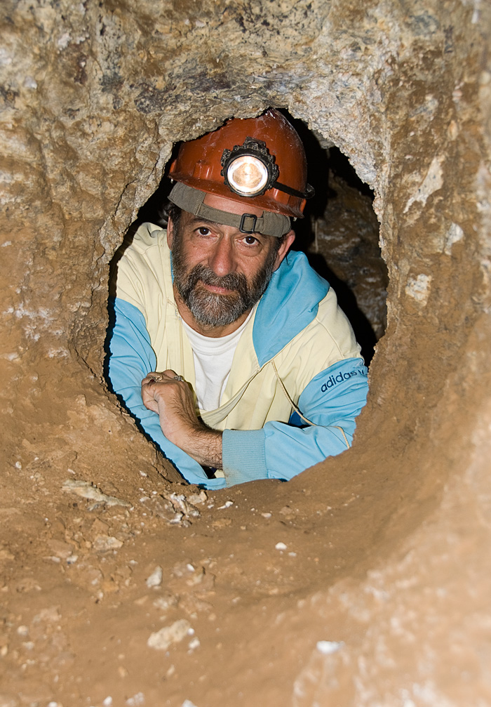 Dana Schorr inside one of the ancient galleries at the storied Kuh-i-Lal spinel mines. Photo: Richard W. Hughes