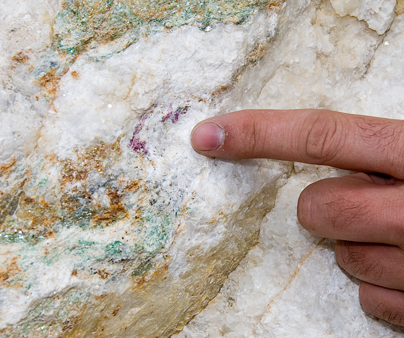 Flecks of red ruby and green fuchsite mica are seen in the marble matrix at the Snezhny ruby mines in eastern Badakhshan. Photo: Richard W. Hughes