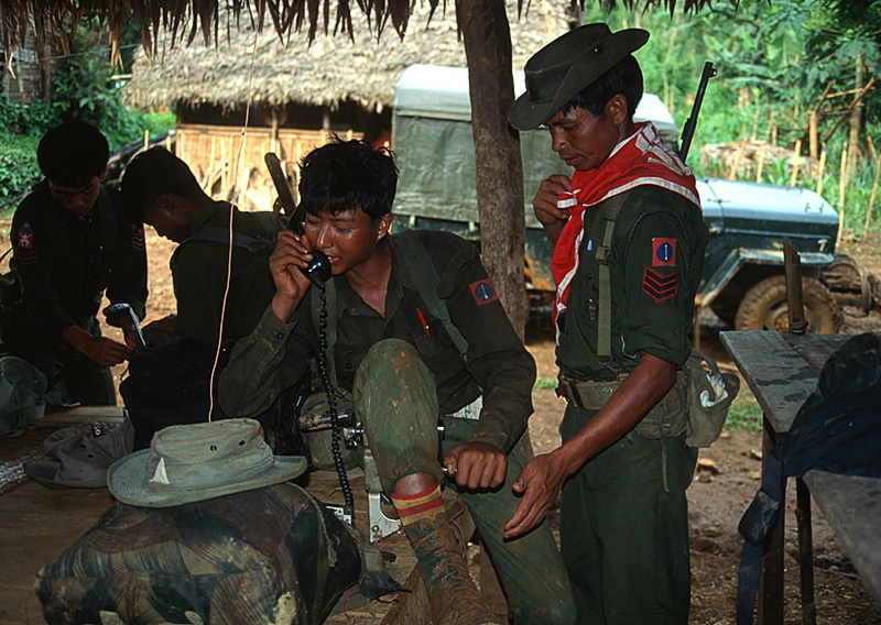 Our military escort radios headquarters from Namlam, deep in Burma's Kachin State.