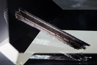 This cluster of large tubes was cut through on both ends inside of a spinel. Specimen courtesy of Global Spinel Gems.