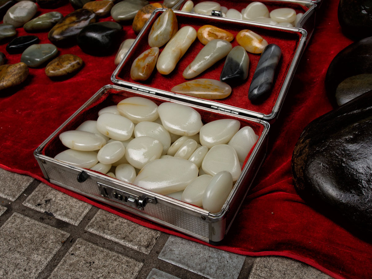 A suitcase of what appears to be Chinese nephrite in Guangzhou's Hualin Street jade market. Like many gem markets, caveat emptor is the norm as imitations abound. Lotus gemology on jade, nephrite, and imitations.