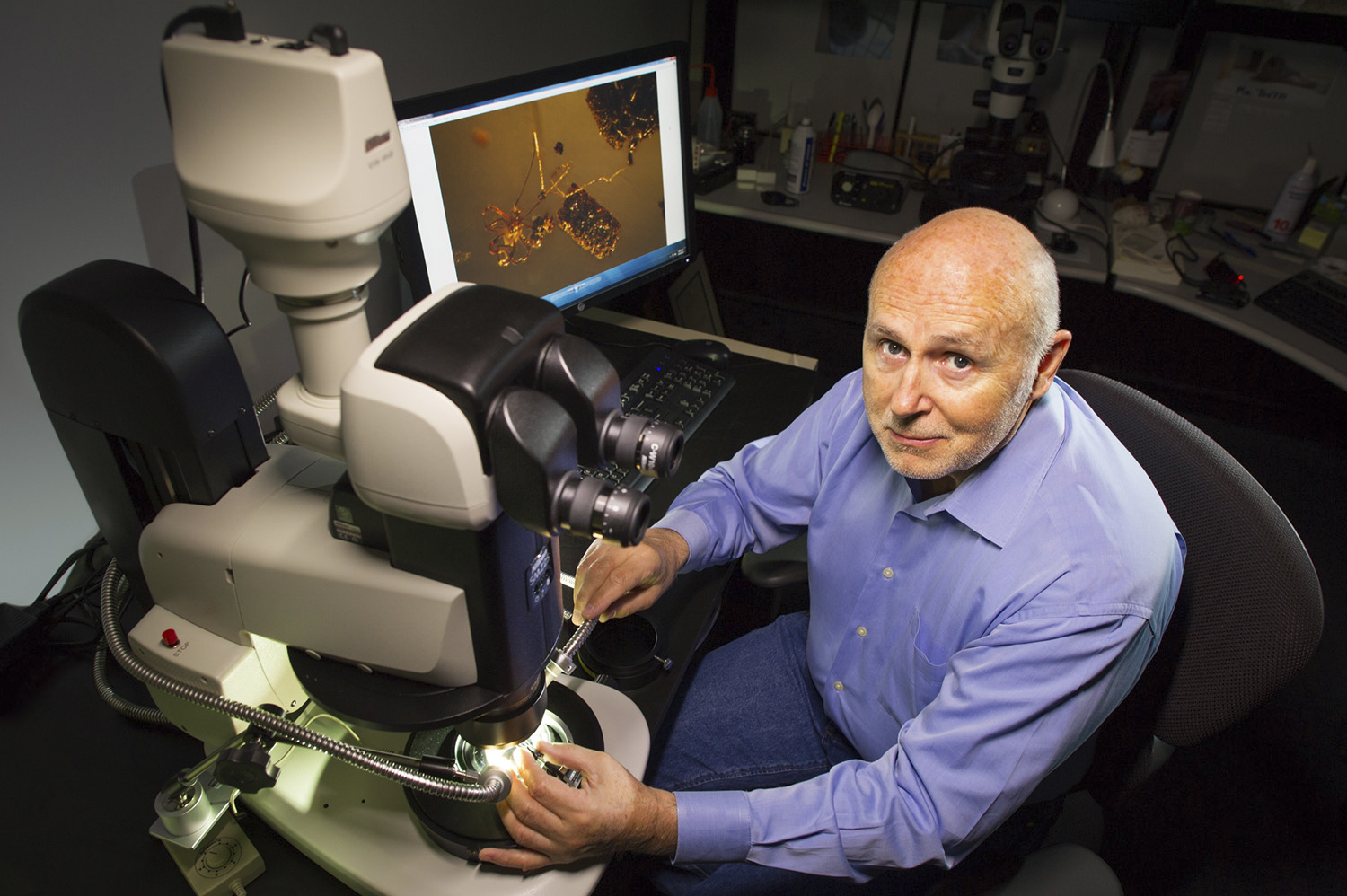 The world's foremost authority on inclusions in gemstones, John Koivula, with his advanced Nikon SMZ25 stereoscopic microscope with built-in image stacking capability. Image stacking is commonly used today to increase the depth of field for a medium that has extreme limits due to the high magnification.