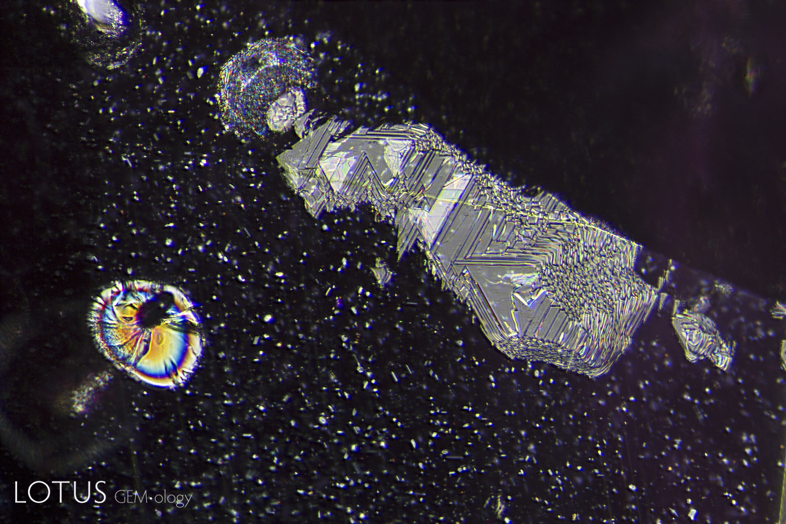 Left: A heat-altered crystal with an iridescent decrepitation halo, alongside a surface cavity filled with glass.
