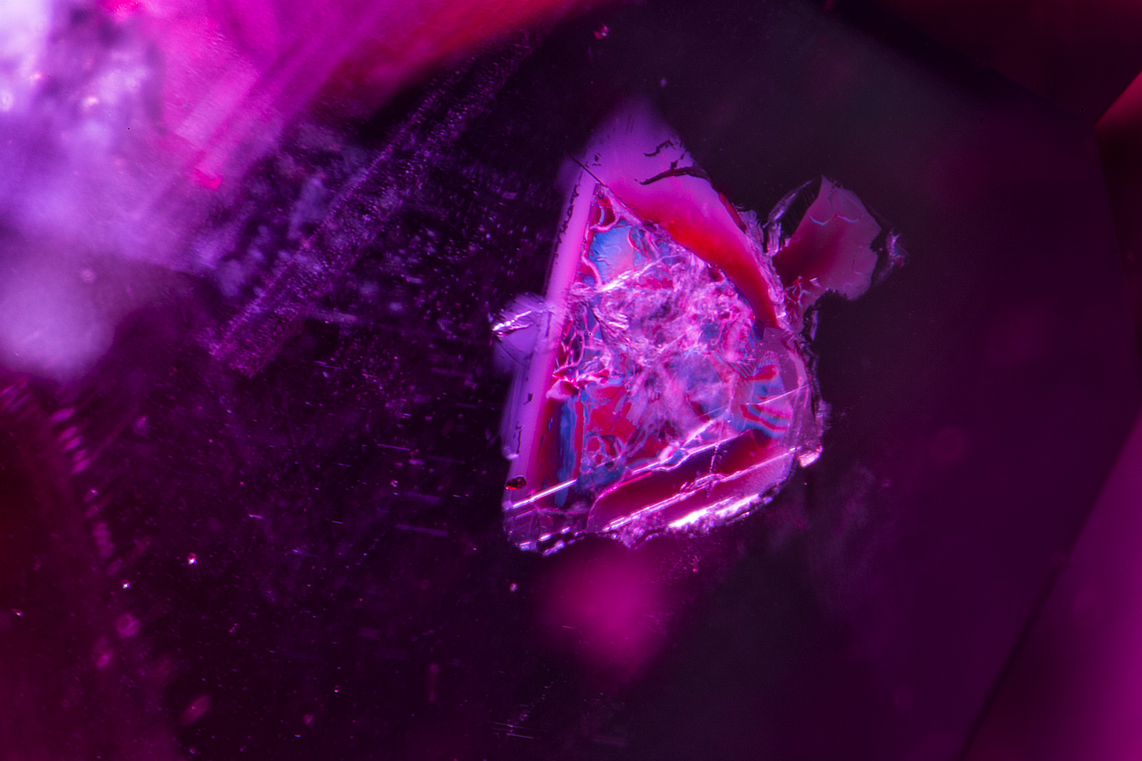 Another crystal of what appears to be mica in a ruby from the new Madagascar find. Photo: R.W. Hughes/Lotus Gemology.