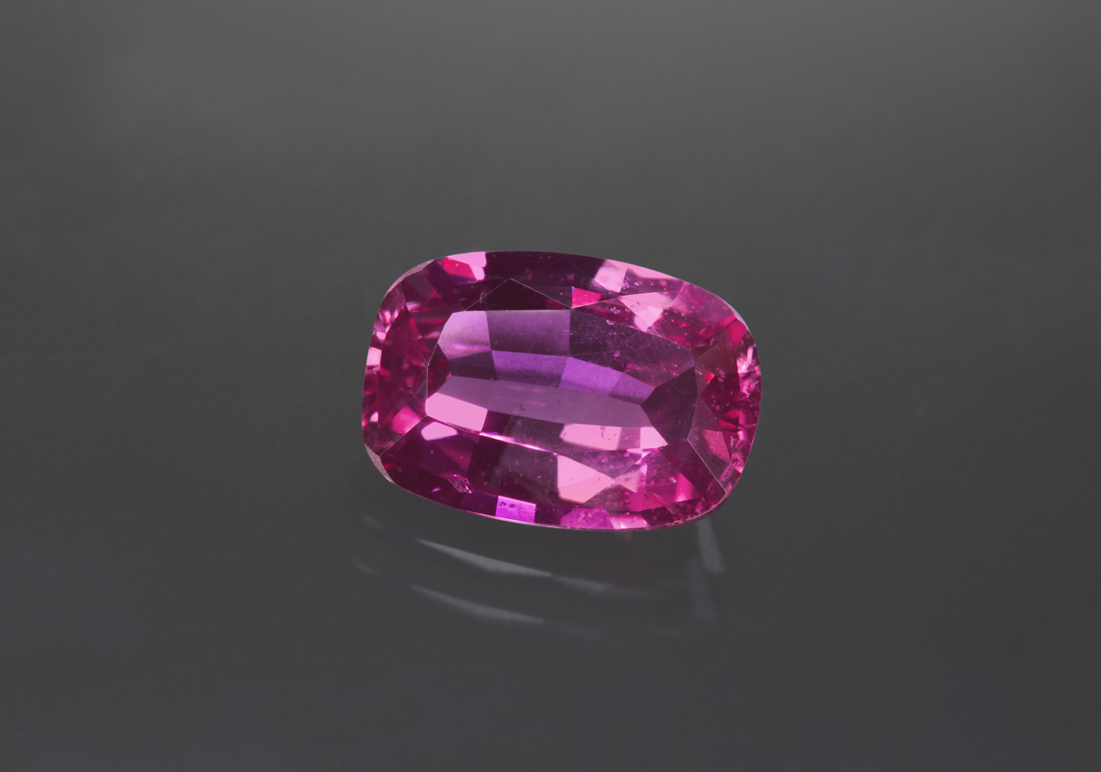 This six carat ruby is an example of the more open color that is also found at the new deposit. Photo: Wimon Manorotkul/Lotus Gemology; gem: Daniel Sherf/Shoham. Click on the photo for a larger image.