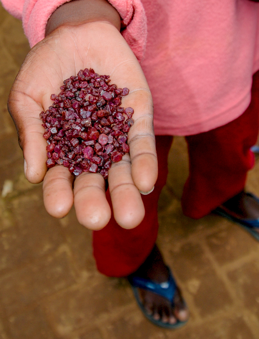 Ruby from Moramanga on offer in the market at Andilamena, Madagascar in September 2005. Photo: R.W. Hughes. Click on the photo for a larger image.