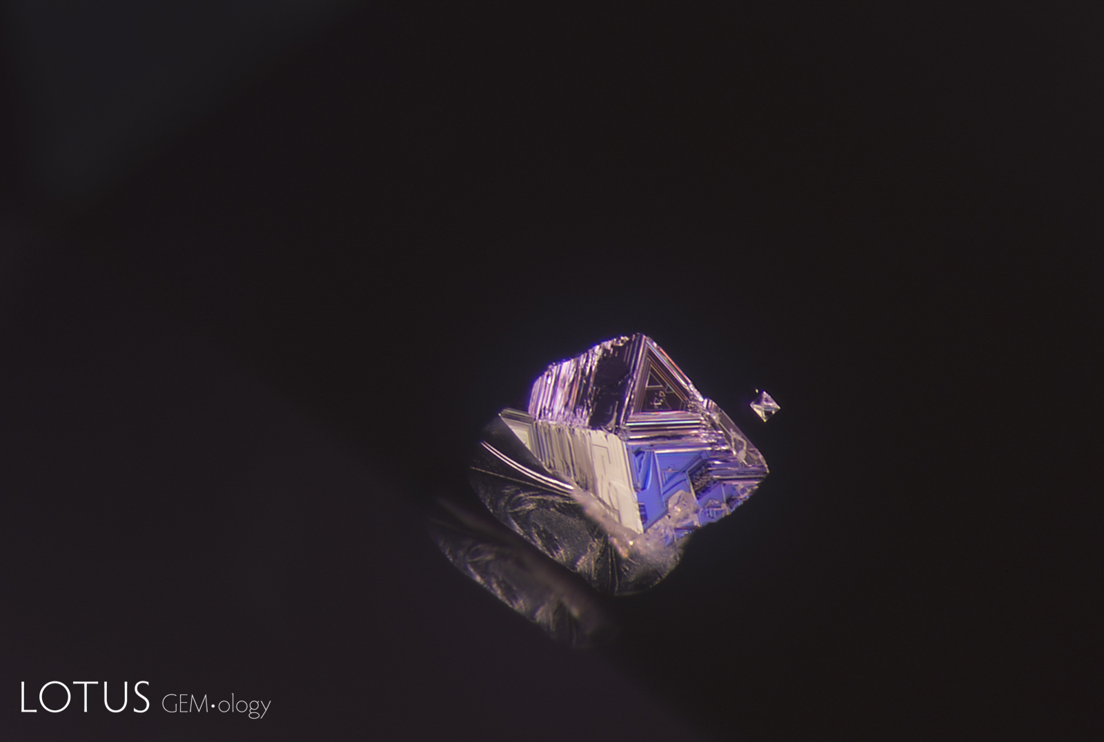 A spinel octahedron, frozen in time; Sri Lanka. Photo: E. Billie Hughes; click on the image for a larger photo