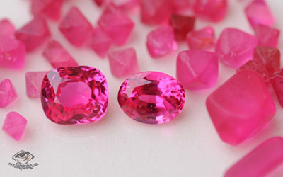 Hot pink spinels in rough and cut form from Namya, Burma. Photo: V. Pardieu, 2005.