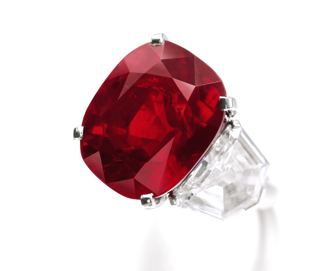 The Sunrise Ruby, a 25.59 ct Burmese ruby ring by Cartier sold for US$32.42 million ($1,266,901/ct) at Sotheby's Geneva on 12 May, 2015, a per carat and total price world ruby auction record. It currently holds the title as the most expensive colored gemstone in the world. Image © Sotheby's