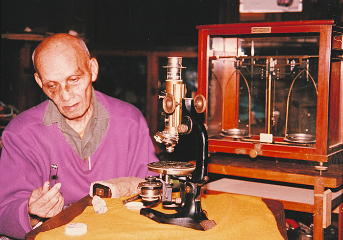 U Thu Daw of Mogok with his microscope formerly owned by ACD Pain