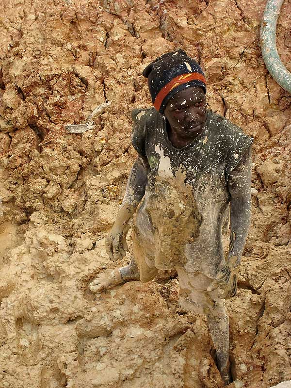 A mud-spattered sapphire miner at Ngembambili Amanimakoro, Songea. Photo: Richard W. Hughes
