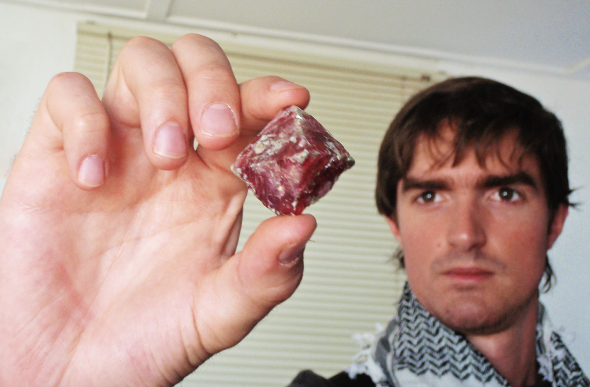 Philippe Brunot holding a spinel crystal from Mahenge. Photo © Guillaume Soubiraa