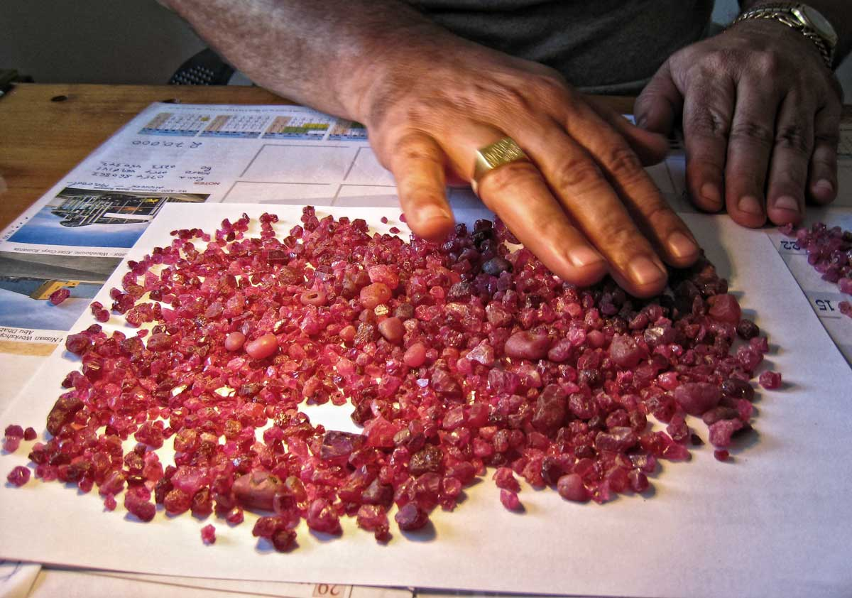 A bit of candy in the office of Spiro, a Morogoro-based Greek dealer. Rough spinel from the Summer 2007 find at Mahenge. Photo:  Richard W. Hughes
