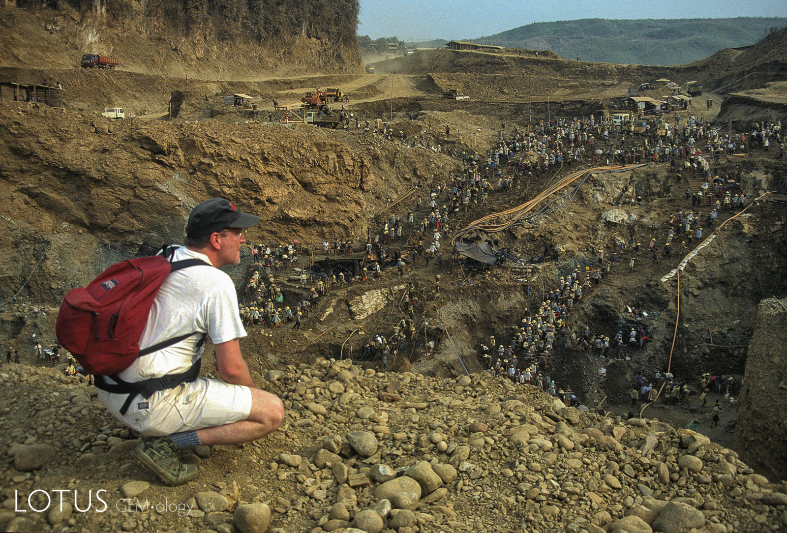 In 1997, I was back for more, this time in the dry season. Crossing a small hill from Hpakan, was a site that still leaves me stunned. Thousands of miners carry rock out of a huge hole. It was one of the most extraordinary sights I've ever seen in my life.
