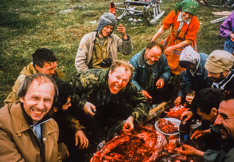 Nickolai Kouznetsov enjoying nyamnyukh (raw reindeer meat) and spirt (grain alcohol) with the Khant people near Kechpel (western Polar Urals).