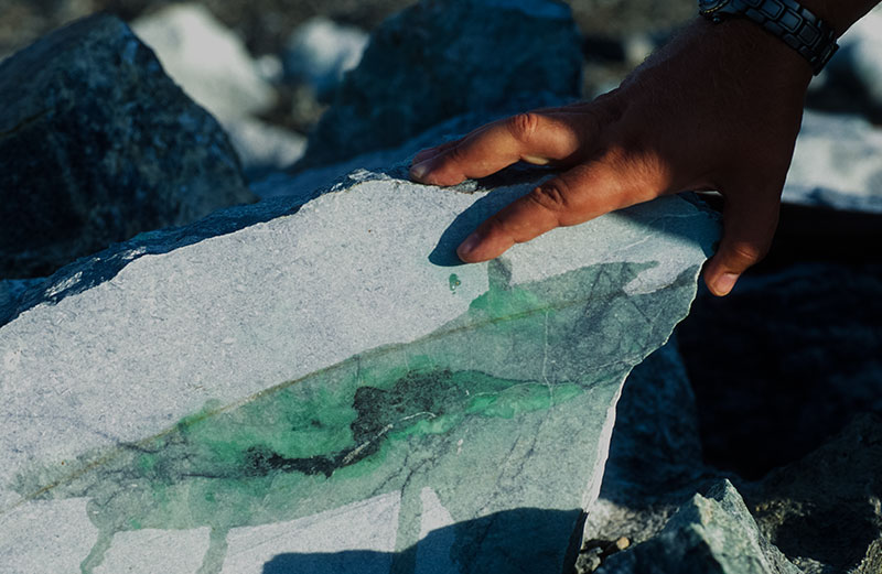 Green veins are clearly visible in this large block of jadeite at Lot 88 in the Polar Urals jade mines