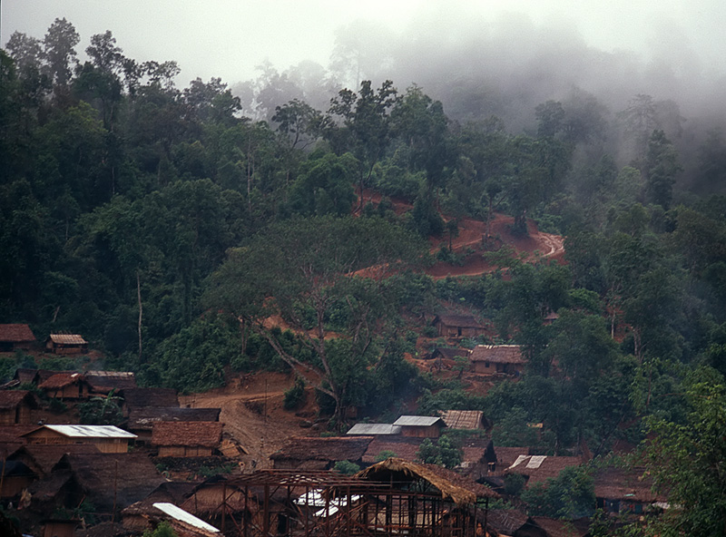 The small village of Hweka, with the rain-soaked track to Hpakan leading into the mist