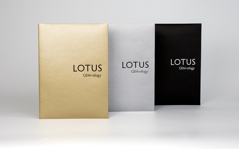 Lotus Gold, Silver and Black softcover reports. Lotus Gemology's report covers are color coded so that one can quickly understand the identity of the gem. Rather than hiding treatment information behind arcane codes, Lotus Gemology is the world's only lab that makes clear the treatment status. Lotus Gold is reserved for untreated gems, Lotus Silver for gems treated by industry-standard techniques and Lotus Black for heavily treated or man-made gems.